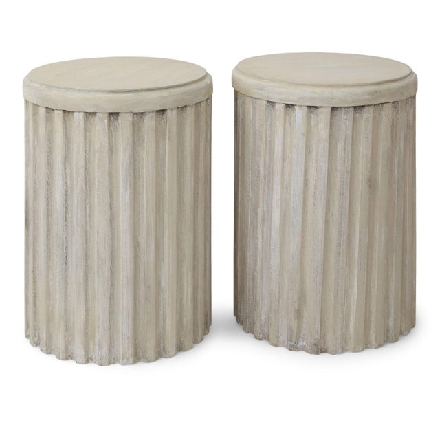 Two painted pedestal tables carved in wood with fluted sides and top. Perfect for a small side table or large drinks...