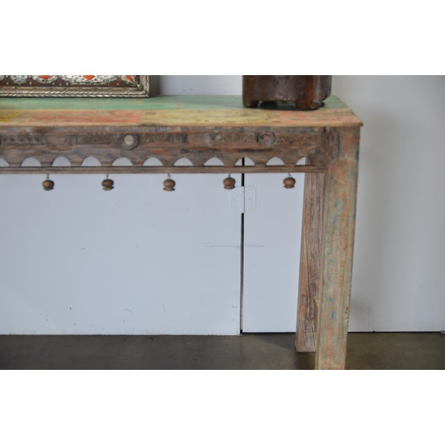 Made from teak, this console is simple and elegant, Made from reclaimed architectural elements and by hand, it's a...