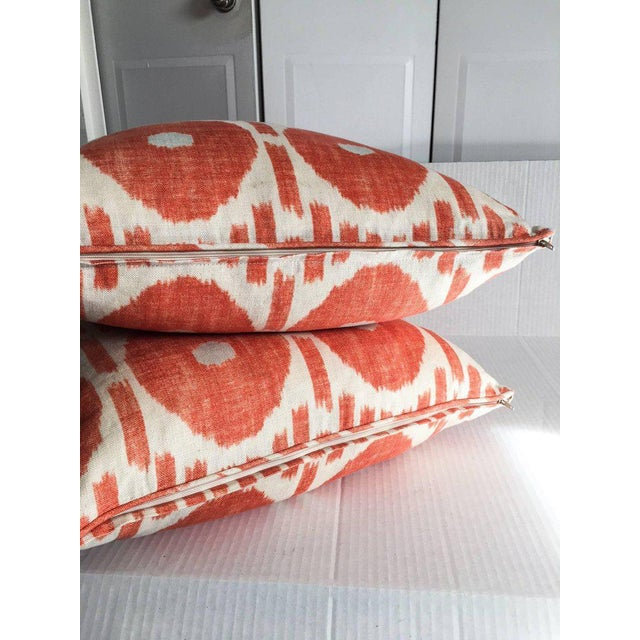 Striking pair of 100% linen cream and orange pillows in Mesa Ikat by Thibaut. Down inserts are included. Each, 20 x 20....