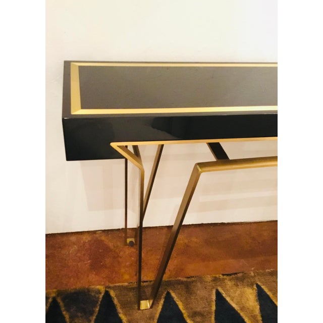 Original retail $7800, elegant Caracole Signature classically modern black and gold moderniste console table, brass...