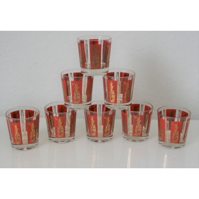 This is a set of 8 red and gold lowball rock cocktail glasses that feature Mandalay Thai Goddess around the glasses. The...