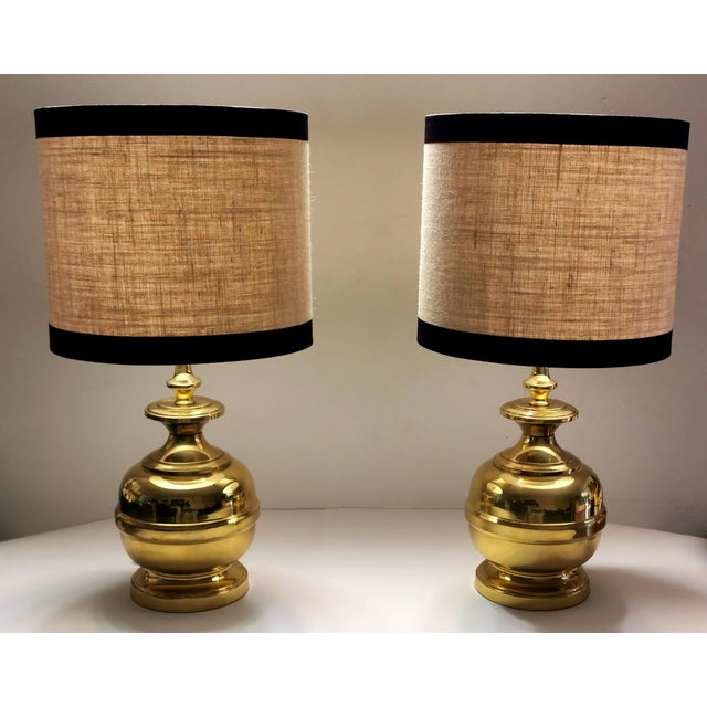 Pair of large Italian table lamps; the thick brass plate was worked on a manual lathe in several pieces that were then...