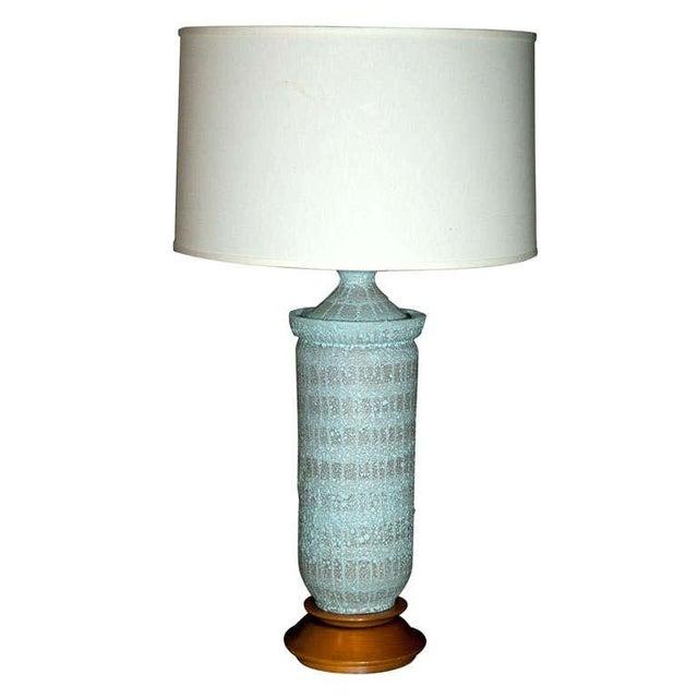 Fine quality ceramic lamp with beautiful wood base.