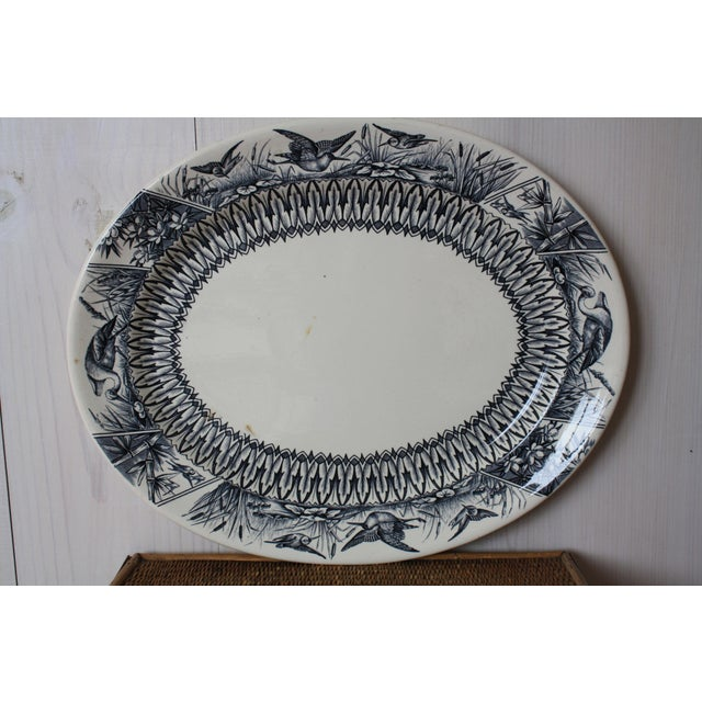 Gorgeous antique English platter from E.J.D. Bodley made in the 1880s! This beautiful piece of transferware has a cream...