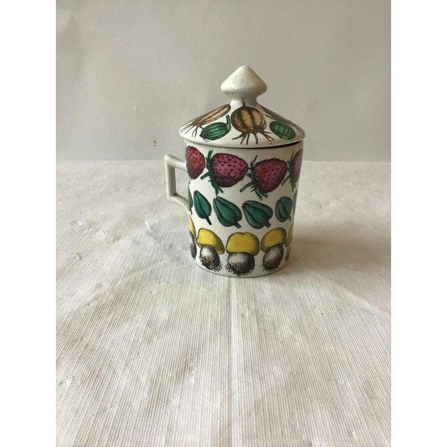 1960s Fornasetti Giostra Di Frutta mug with lid.