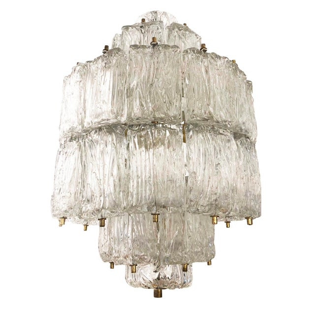 1950's Murano glass chandelier by Barovier and Toso composed of dozens of tiered textured glasses with brass fittings....