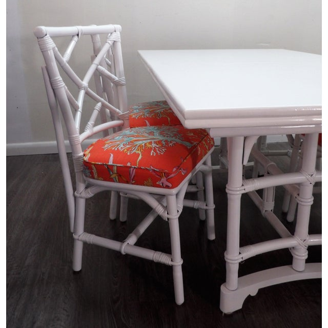 In a new white lacquer finish and new coral upholstered seats is this striking Chinoiserie style dining set. The table has...