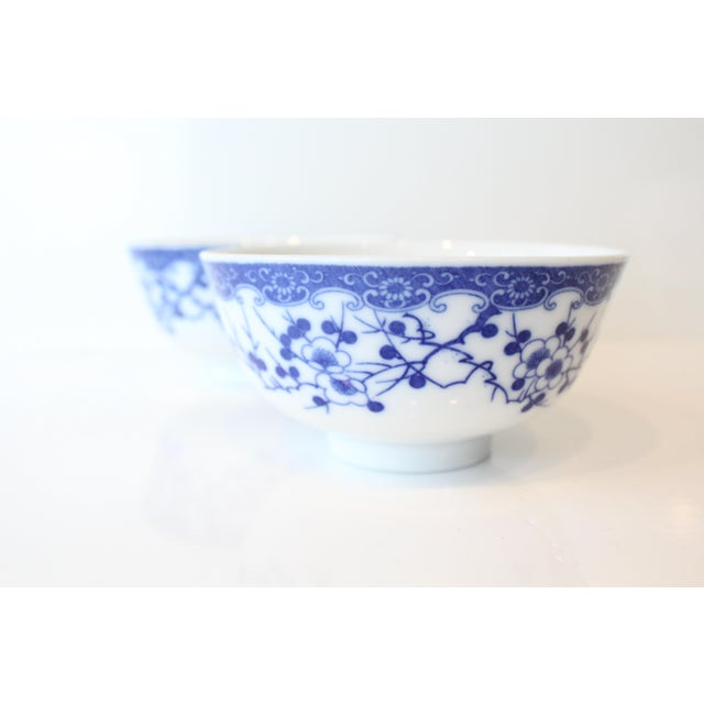 Beautiful blue and white Chinese porcelain cobalt rice bowls with modern floral detail.