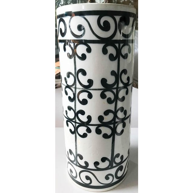 Fun glazed graphics adorn this mid century Spanish ceramic/pottery umbrella stand or vase. Depending on your needs or...