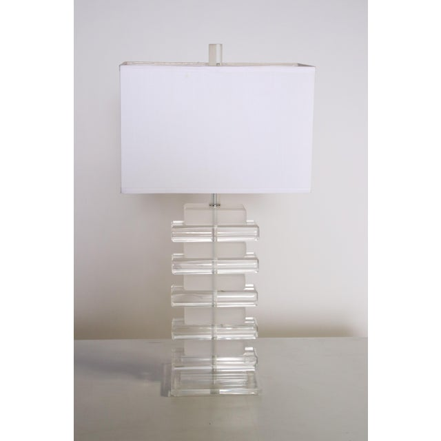 1970's table lamp with alternating stacks of frosted and clear lucite. Wired and in excellent working condition. Lamp...