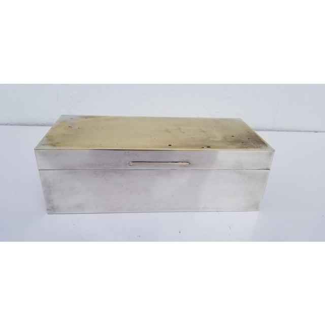 Vintage mid-century modern rectangular shape Silver plate decorative box. The interior has the original mahogany wood...