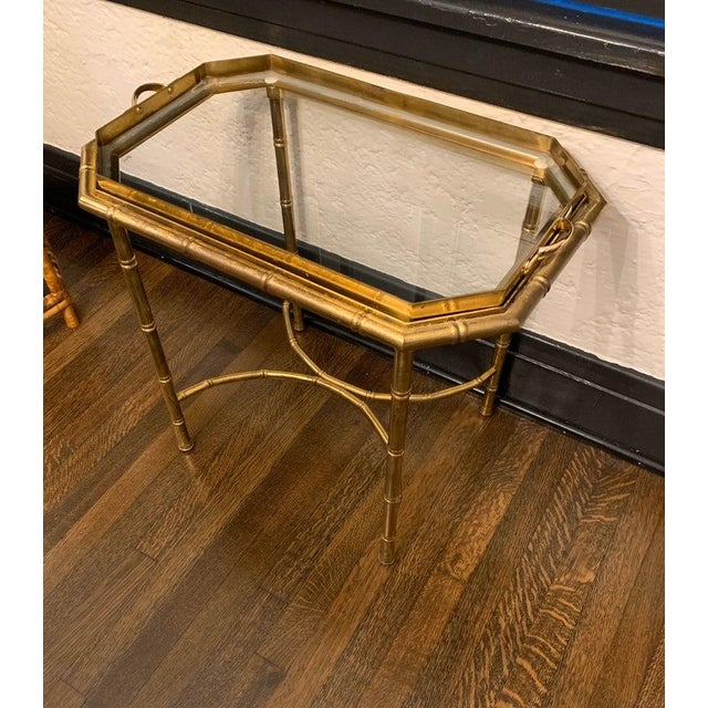 Gorgeous brass bamboo end table in the style of Mastercraft. Tray lifts off completely for easy serving.