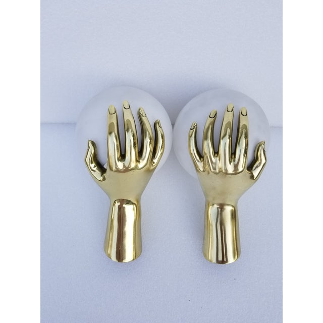 Superb and very rare in bronze color pair of hands sconces by Maison Arlus. Model number 1436, figuring a bronze hand...