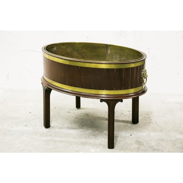 This is a classic oval English George III style period appropriate mahogany wine cooler. The exterior walls are...
