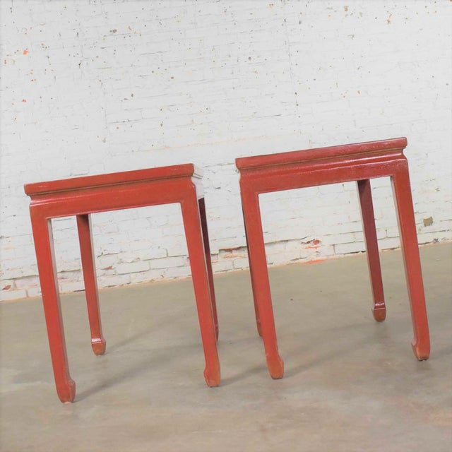 Handsome pair of Asian Ming style Chinese red lacquer with a crackle finish rectangular shaped end tables or side tables....