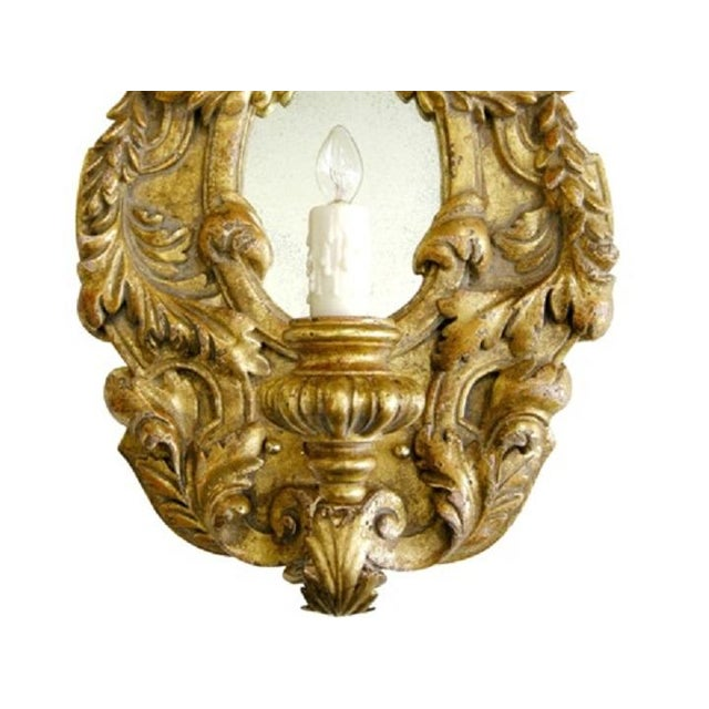Extrordinary Italian Gilt-wood Designer Sconce. Entitled Juliette. Classic Italian form with a single light and carved...