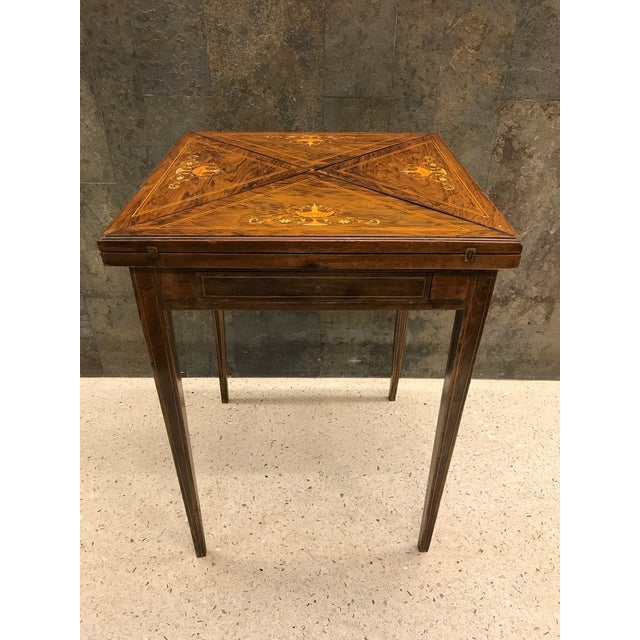 French, rosewood inlay handkerchief game table. Has the original leather top with gold tooling. Measures (closed) 22W x...