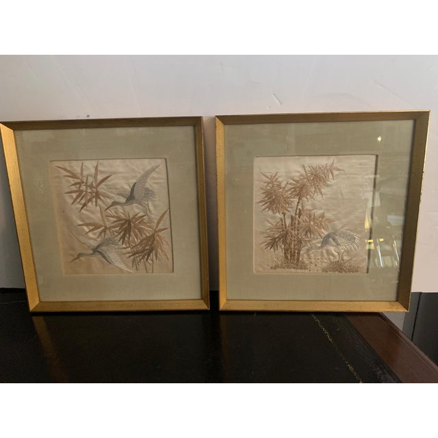 Lovely pair of fine silk needlework of herons and bamboo having subtle color palette of platinum grey, silver, white and...