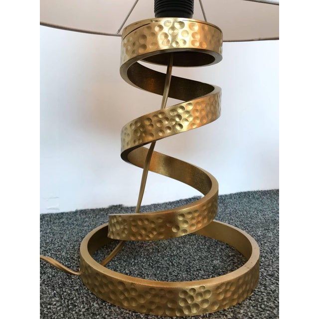 Spiral pair of table or bedside lamps by the designer Luciano Frigerio. Hammered brass maybe bronze. Measurement Height...