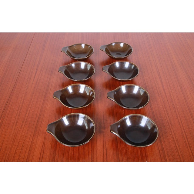A rare set of 1940s American Modern dinnerware designed by Russel Wright for Steubenville Pottery. This set is in the...