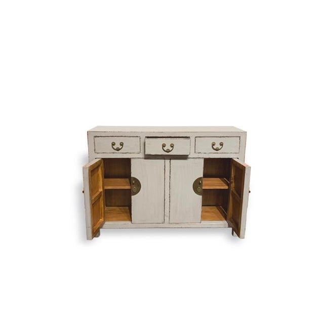 This is a 3 drawer 4 door buffet table with lots of storage. Very simplistic yet beautiful. A great staple in your home.