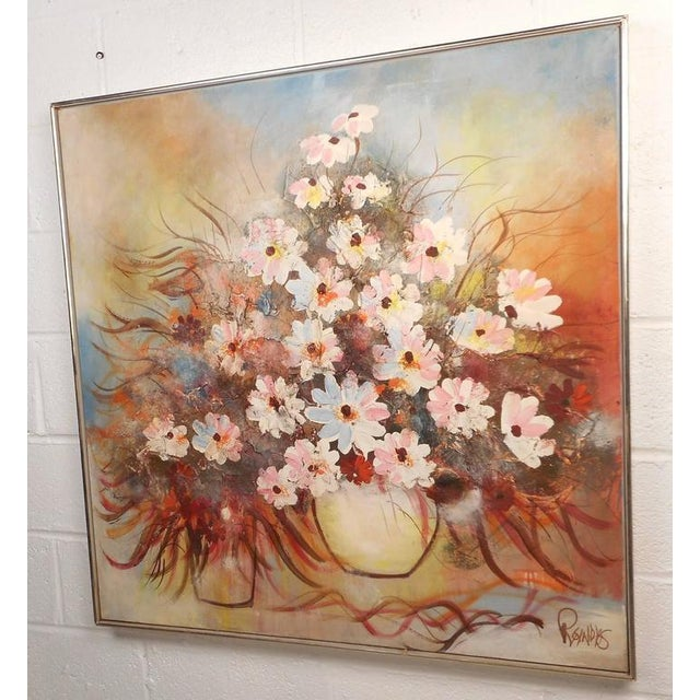 Gorgeous Mid-Century Modern painting features an abundance of flowers in a vase. The eloquent use of colors and sleek...