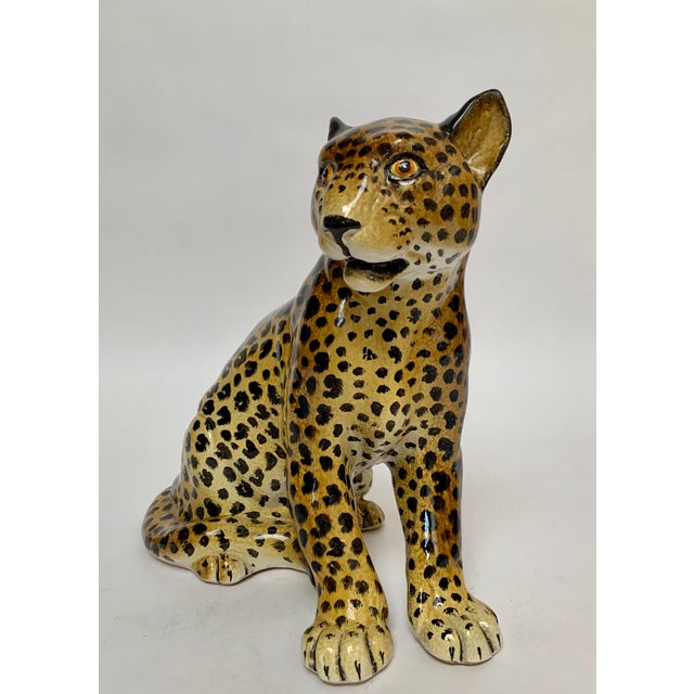 Large and heavy terra cotta leopard sculpture by Manlio Trucco, ca. 1950s. The leopard is hand-painted and measures about...