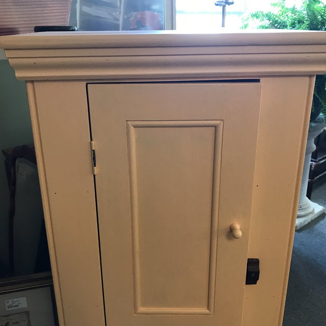 Yellow butter colored pine cupboard with 4 shelves. In good condition, minor chips in paint on interior of door.