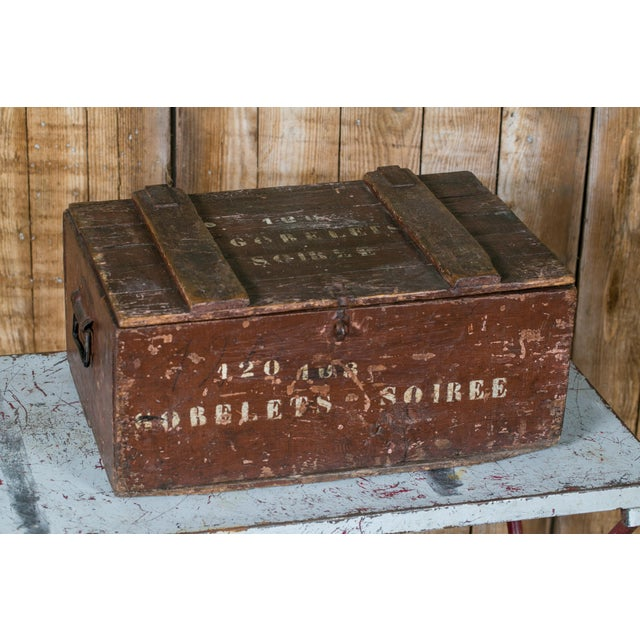 Wonderful antique wooden crate/ trunk with hinged lid and metal handles on the sides. All original paint in oxblood red...