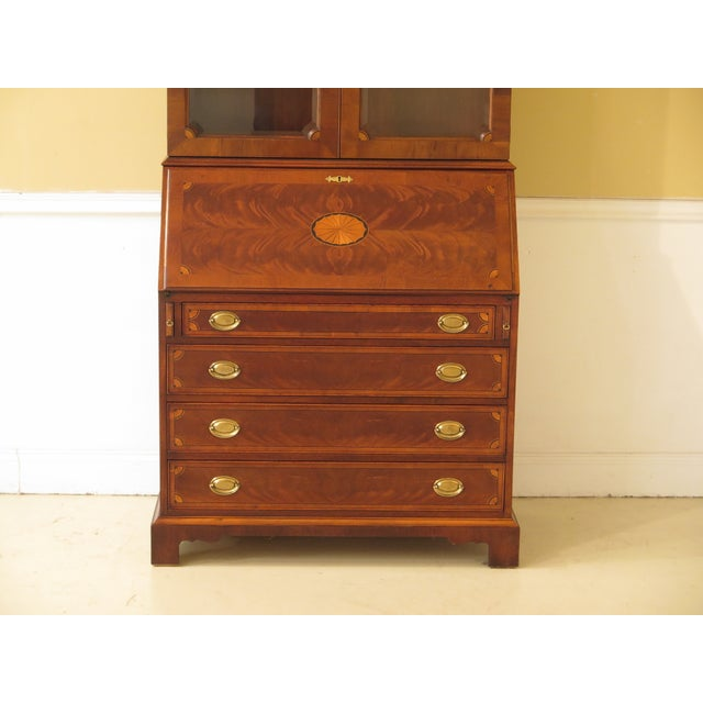 HEKMAN inlaid mahogany & yew wood secretary desk. Approx: 25 years old. Beveled glass doors. Dovetailed drawer...