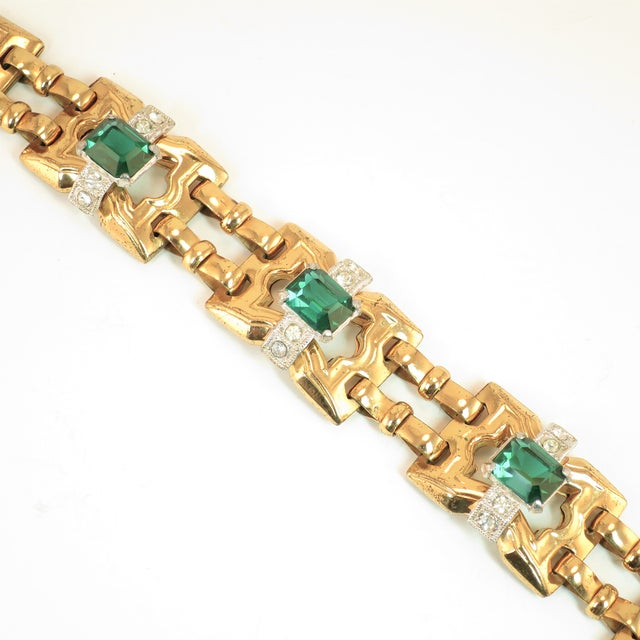 Offered here is a McClelland Barclay Art Deco gold-plated link bracelet from the 1930s. This classic Art Deco piece...