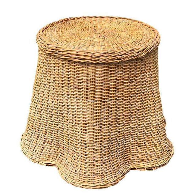 1970s round sculptural handcrafted Trompe L'oeil rattan draped-sheet or ghost table. The table is handwoven in warm honey-...