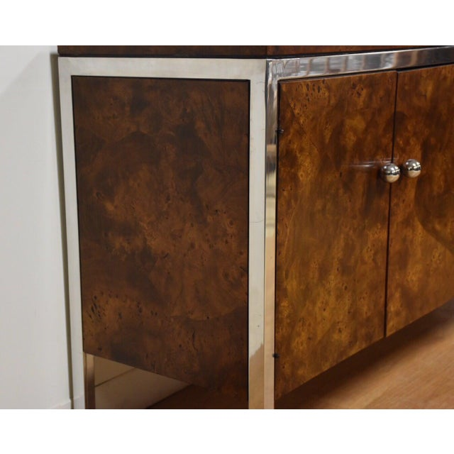 """A gleaming sideboard made of burl wood with a polished chrome contrasting frame and ball knobs made by Tomlinson. 68""""..."""