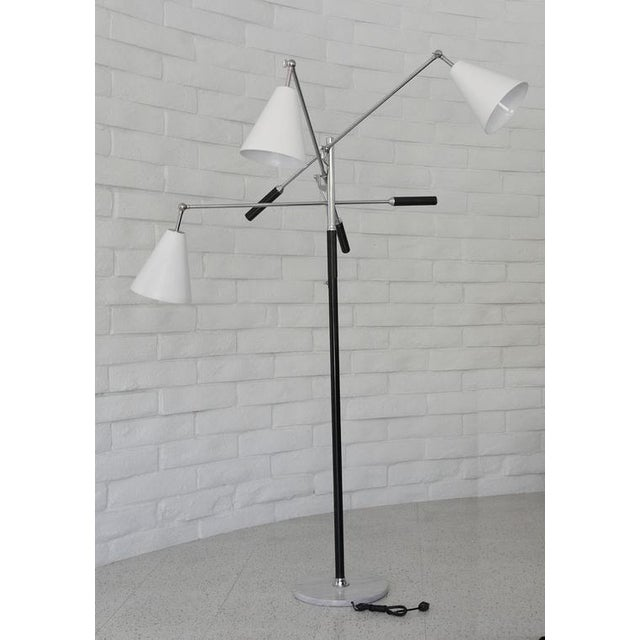 Classic Triennale articulating three-arm floor lamp. Carrara marble base, nickel chrome, three white shades and leather...