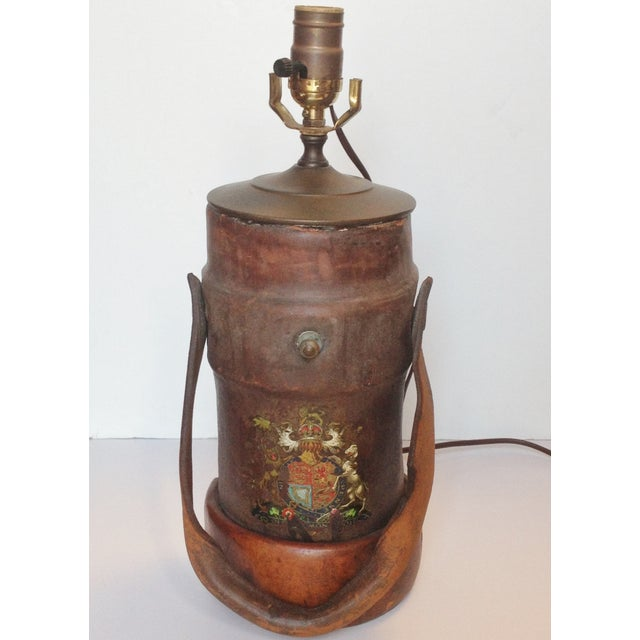 Offered is a handsome leather fire bucket with the Great Britain coat of arms, made into a table lamp. In very good...