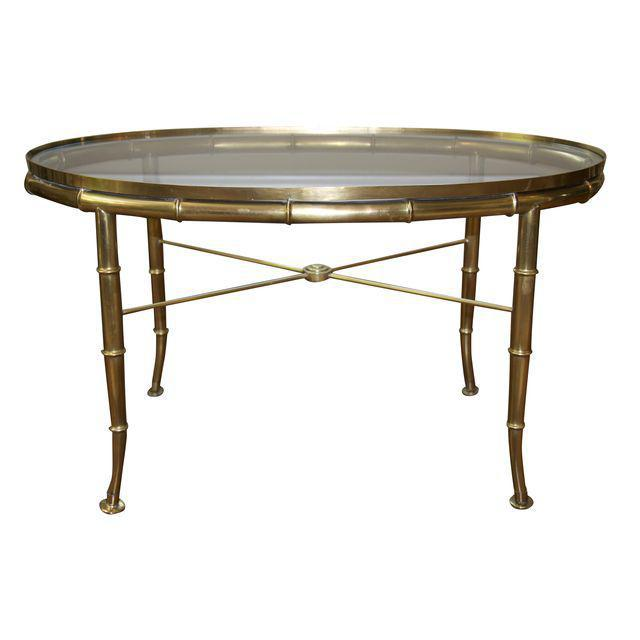 This Mastercraft bamboo-motif cocktail table is a perfect size with proportions best described as lovely and delicate. It...