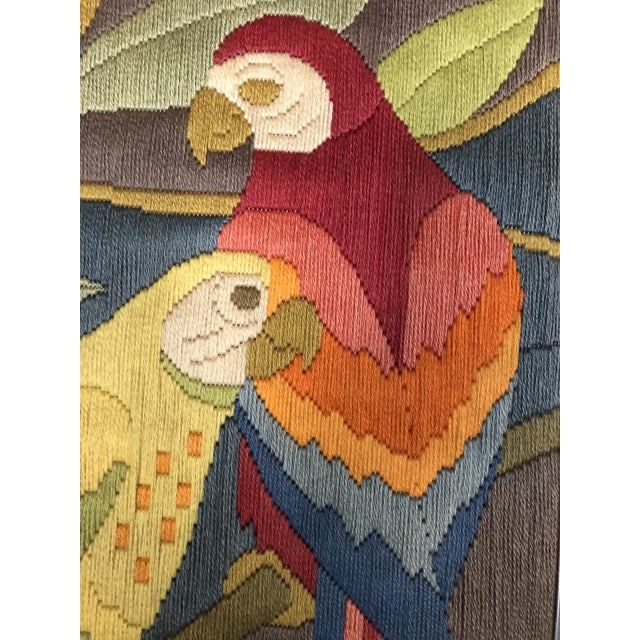 Mid-Century Modern Hand Crafted Parrot Needlepoint Artwork in Lucite Frame This 1970's large needlepoint textile art that...