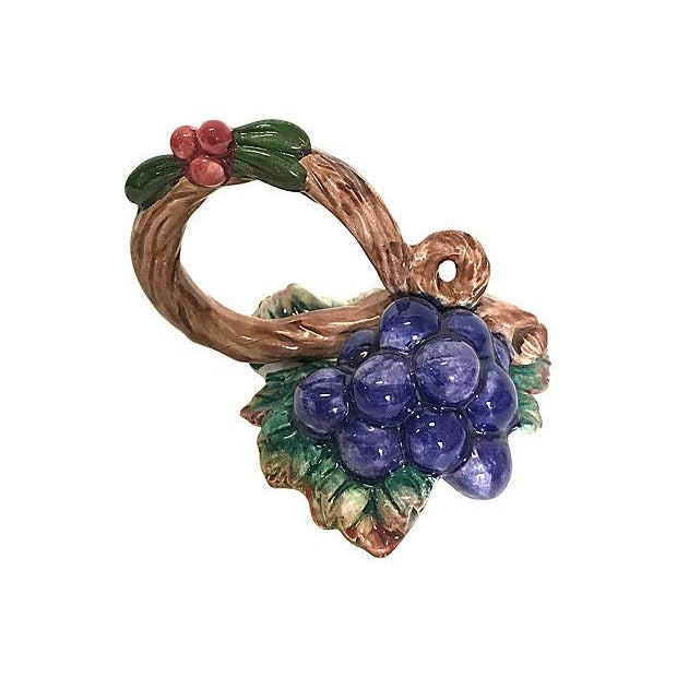 """Set of 11 grapevine napkin rings by Fitz & Floyd. Marked, """"FF, """" """"Hand Painted, """" """"Taiwan"""" and """"1993."""" Appear to have..."""
