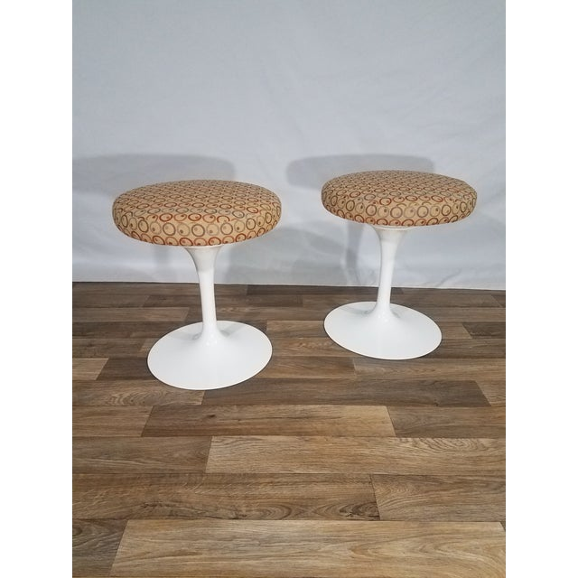 "These unique and modern tulip stools are designed by Eero Saarinen in 1957. Saarinen vowed to address the so called ""slum..."