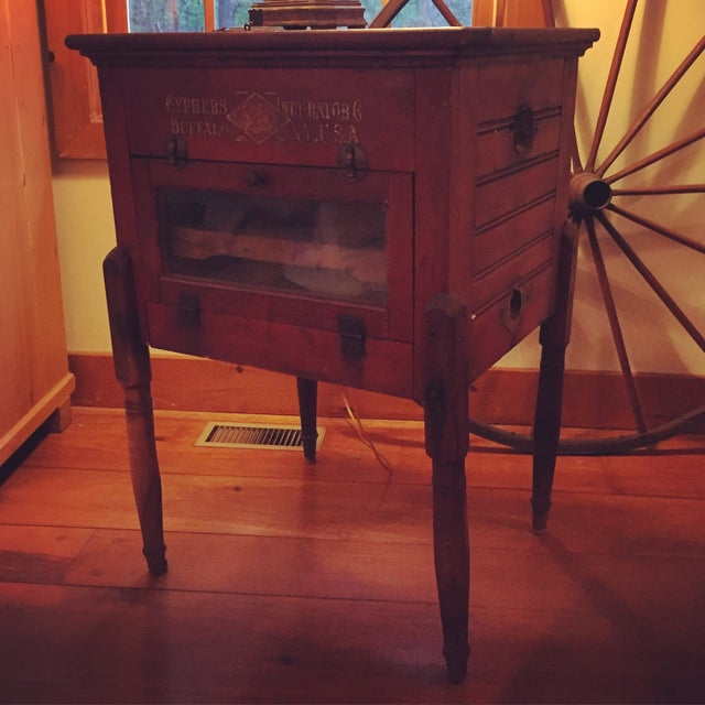 From the early 1900's, this is a unique table for any home with rustic or farmhouse decor. Still has working warming light...