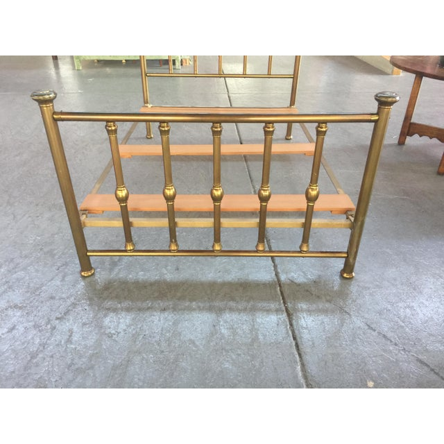Antique Brass Bed, full size, with rails and supports. In overall excellent condition. the only flaw is a few dents in the...