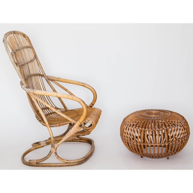 Mid-Century rattan lounge chair / rocker and round footstool pouf attributed to Franco Albini. The chair is designed to...