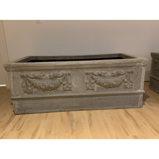 Grand Pair of classical planters with lovely swag detailing in a faux lead resin. Light weight, easy to move around ready...