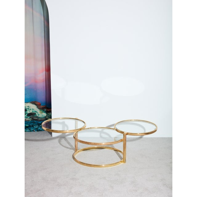 Vintage circa 1970s brass coffee table with three surfaces. The top two surfaces can swivel outward to create a unique...