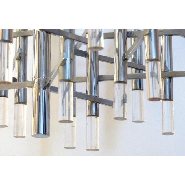 Offered for sale is a 1970's Modernist chandelier by the Italian lighting designer Gaetano Sciolari created in an angular...