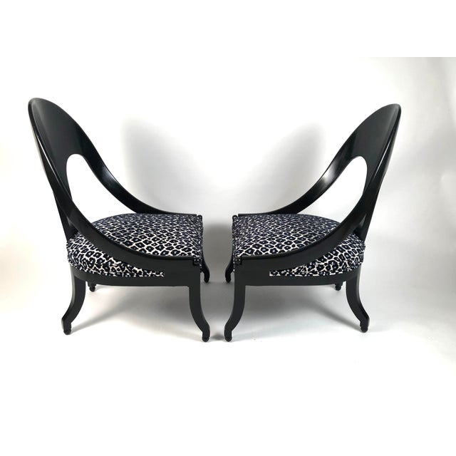 A pair of stylish and comfortable Regency style ebonized wood spoon back chairs with newly upholstered seats in a high...
