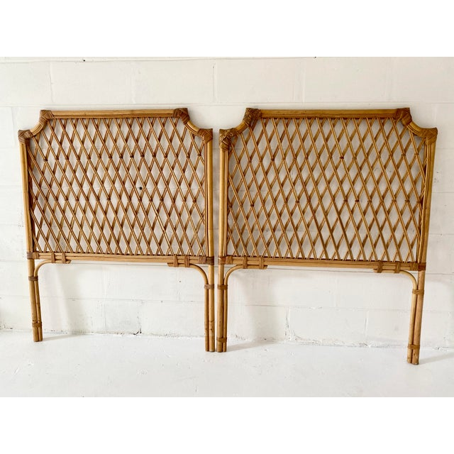 Vintage pair of rattan twin headboards. Wrapped joints with criss crossed pencil reeds. Classic Palm Beach Regency style.