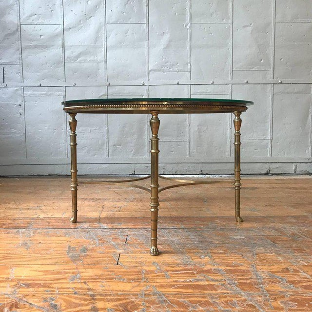 Handsome brass coffee table with an etched glass top, French, 1940s.