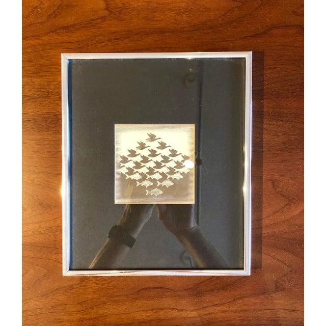 Beautifull lithograph print, framed with black mat. About the Artist: World-famous graphic artist M.C. Escher's art was...