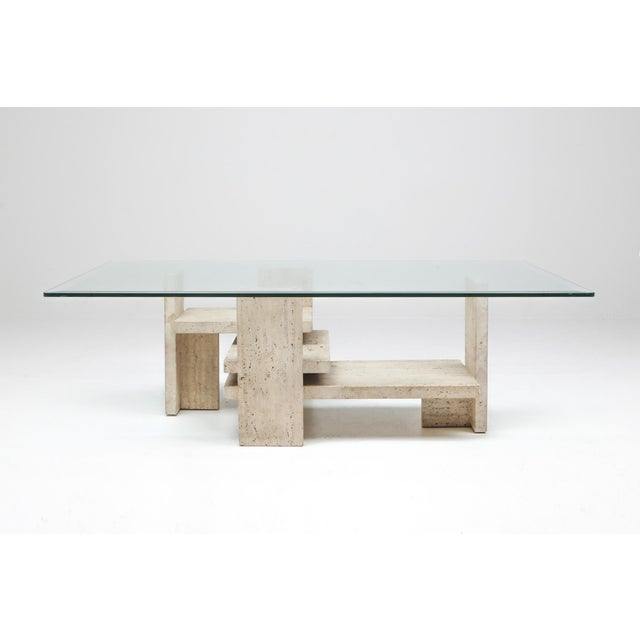 Post-modern coffee table, architectural, geometrical, travertine, France 1970s. Minimalist modern piece that fits well in...